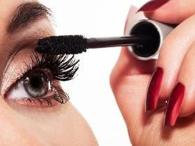 Close up of woman applying makeup mascara